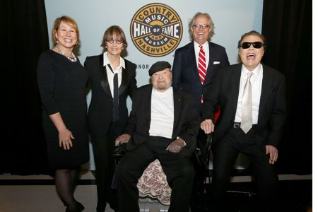 CMA CEO Sarah Trahern; Suzi Cochran, widow of Hank Cochran; Mac Wiseman; Country Music Hall of Fame and Museum Director Kyle Young; and Ronnie Milsap.