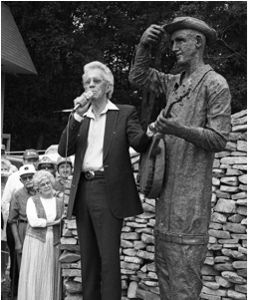 Porter Wagoner at the dedication of the Stringbean statue at the inaugural Stringbean Memorial Bluegrass Festival in 1996.  Grandpa Jones and his wife Ramona are seen looking on from the side.
